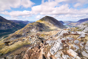 Views of the summit of High Crag, Ennerdale valley and Buttermere from the mountain summit of Hay Stacks in the English Lake District.