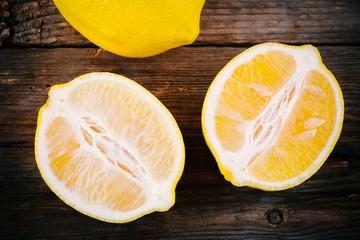 Fresh ripe lemon slices on wooden background