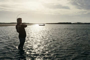 Young Adult Angler hooked up to a Fish while Wading
