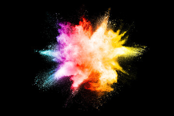 Explosion of colored powder isolated on black background.