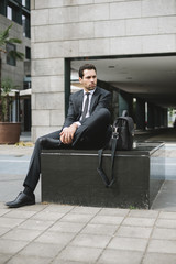 Young businessman relaxing in the city