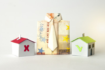 Shirt made with a banknote and two paper houses that represents a mortgage or a loan accepted or refused
