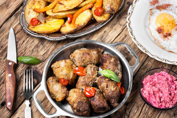 Grilled meat with boiled potatoes