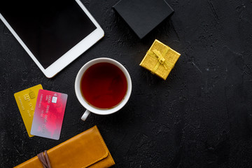 order new year 2018 present with credit card and device on black table background top view