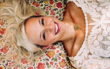 Smiling girl laying on a floral couch