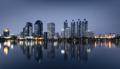 light from modern building bright in night city with skyline. night cityscape concept.