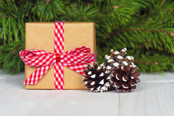 Christmas gift box. Christmas present in gift box at white wooden table. Copy space.