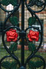 Wrought Iron Gate With Red Roses