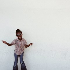 Little girl goofing around with sunglasses on