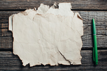 old yellow paper on wooden table