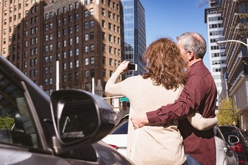 Senior couple taking a selfie on the road