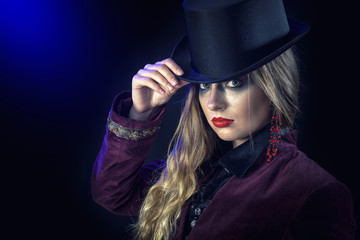 Beautiful woman in hat and leather gloves. Retro fashion model girl.black hat with large fields.Halloween witch
