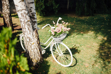 Wedding decor with white bicycle and flowers