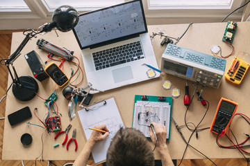 Engineer Testing Electronic Equipment at Home