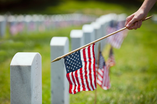Memorial: Boy Placing American Flags By Headstones