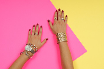 Female hands with jewelry. Fashion accessories, wrist watches, glamor bracelets