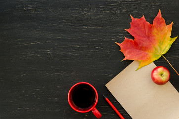 Autumn maple leaf, apple, cup of tea, paper for text and pencil