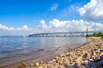 Beach stones, the city's embankment and freeway bridge bay.
