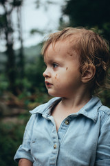 Toddler Girl With Mud on Face From Playing Outdoors