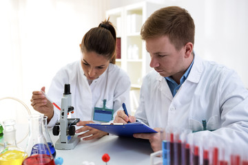 Young scientists making test or research in school lab