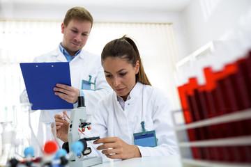 Woman testing sample at laboratory