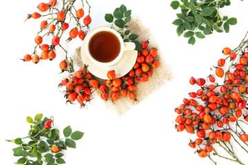 dog rose hips and herbal Te a on white background