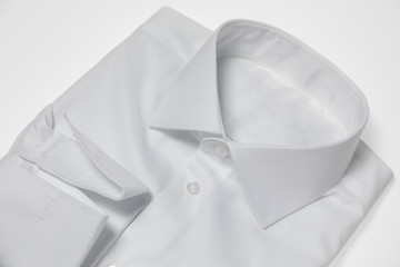 Single Folded and Ironed Male Shirt with a Collar and Buttons, Isolated on White Background