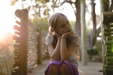 Girl sitting on tree house