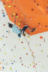 young athletic male climber indoors