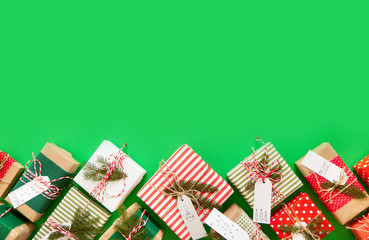 Christmas gifts on a green background. Fir branches.