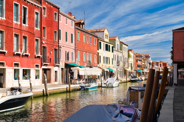 Colorful old houses next to the canal at the island of Murano near Venice