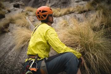 Man preparing for rock mountaineering