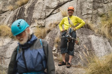 Portrait of happy man standing on rock