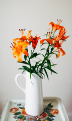 Pitcher of Vibrant Orange Lilies On Vintage Metal Tray