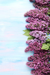 Branch of lilac flowers on wooden table
