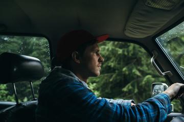 Man driving car in mountains