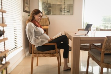 Pregnant woman reading a book