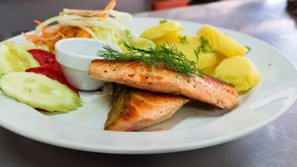 Salmon steak on white dish