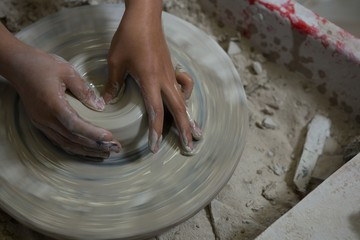 Hands of girl molding a clay