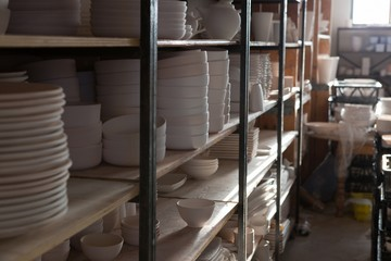 Various crockeries arranged in shelf