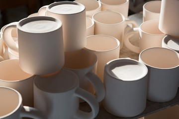 Ceramic mugs arranged on worktop