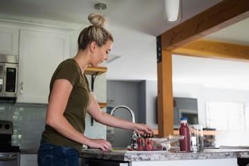 Beautiful woman working in kitchen