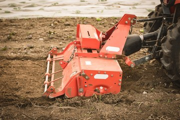 Tractor ploughing field to prepare for seeding