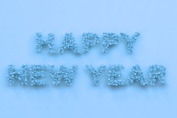 Happy New Year words from blue balls on blue background