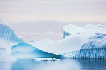 Big blue icebergs floating near the Saqqaq village, western Greenland