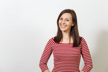 Gorgeous European young happy brown-haired woman with healthy clean skin and charming smile, dressed in casual red and grey clothes, laughing and enjoying on a white background. Emotions concept.