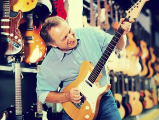 Man choosing electric guitar