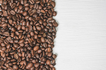 Frame of coffee beans with free space for text, white background top view