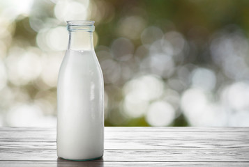 Milk bottle on natural background