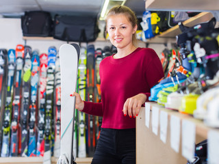 Portrait of client girl who is standing with ski